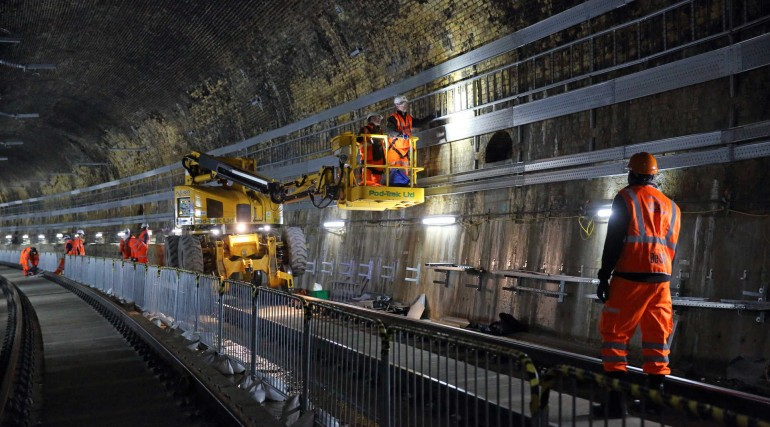 08 Installing overhead catenary system in the Connaught Tunnel_266104
