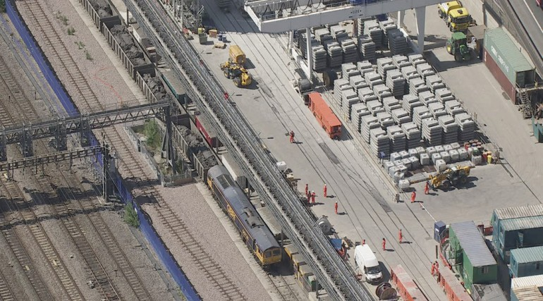 Aerial view of excavated material from Western Tunnels being loaded onto GB Railfreight train at Wes