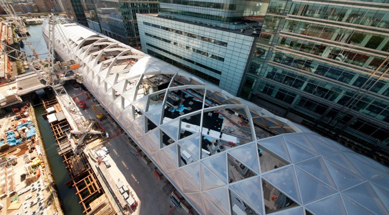 Construction of striking lattice timber roof above Canary Wharf Crossrail station_144123