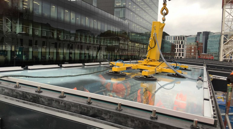 First panels of Spencer Finch_s artwork lifted into place in Paddington station canopy_293323