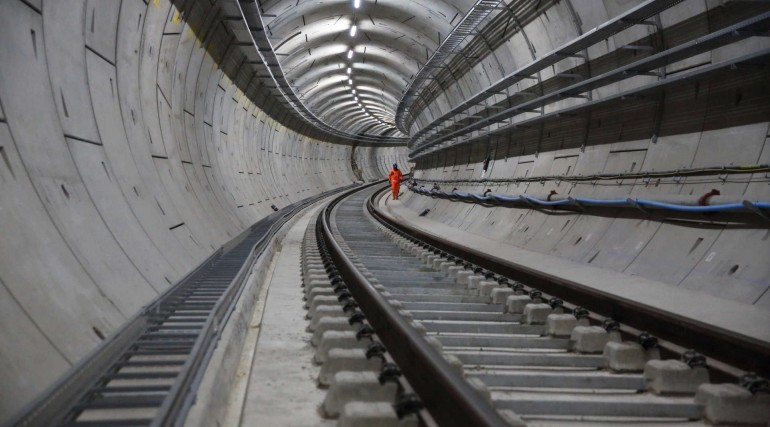Tunnels with completed tracks and racks to carry cabling_257685